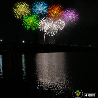 Fireworks stickers added to a photo of real fireworks over Charles River creating a colorful display